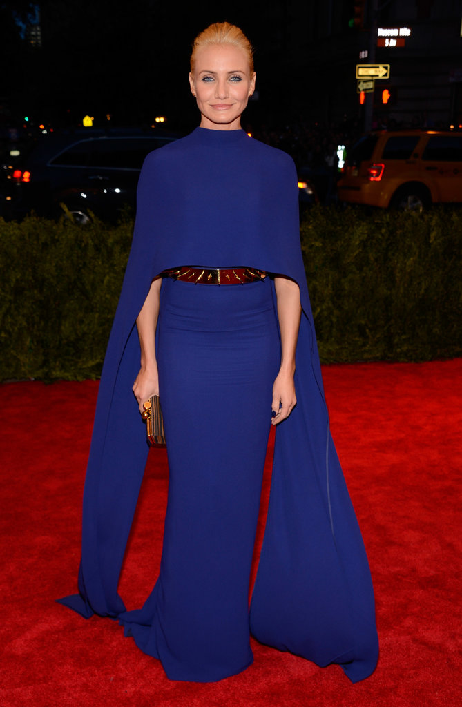 Cameron Diaz added a dash of punk to her cobalt Stella McCartney cape dress with a gold spiked belt.