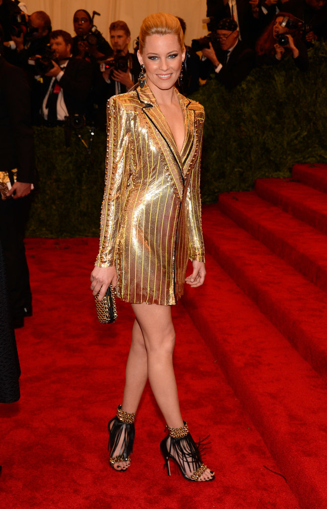 Elizabeth Banks had a golden moment in her Atelier Versace gold metallic blazer dress and black-and-gold fringe Brian Atwood sandals.