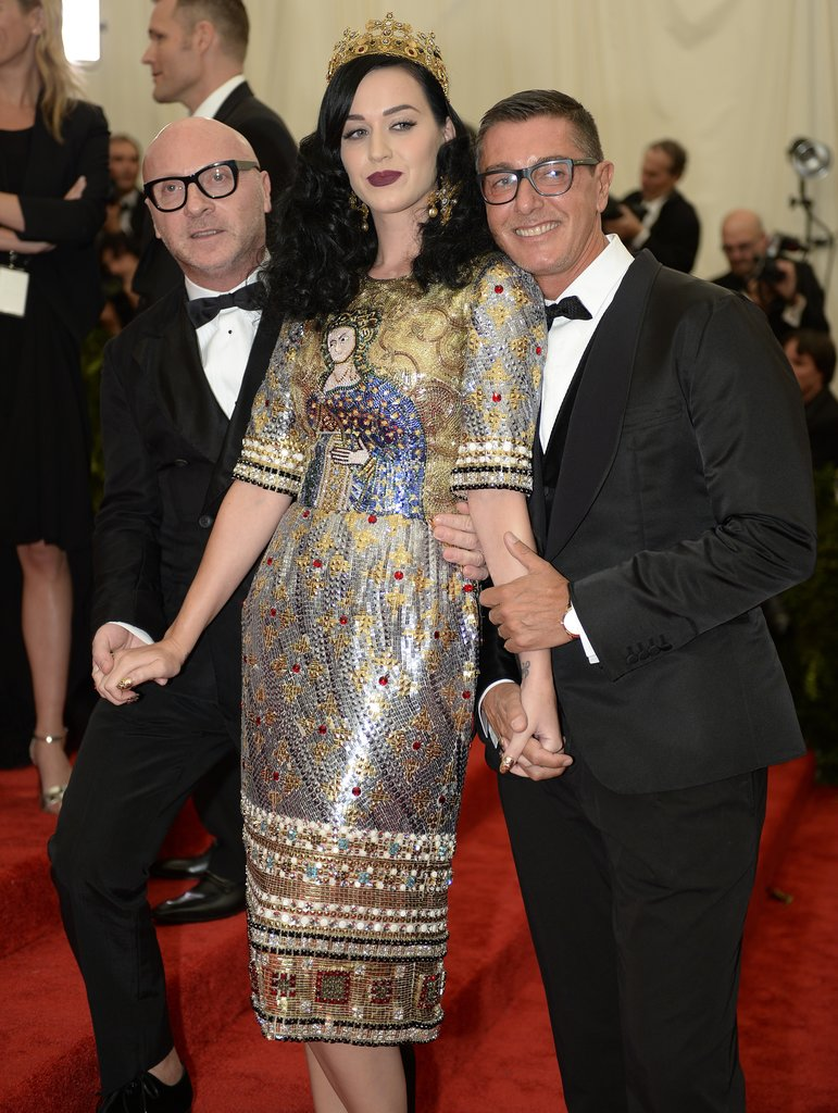 Designing duo Domenico Dolce and Stefano Gabbana posed with Katy Perry, who reached out after seeing her medieval-inspired dress (and crown) on the Fall 2013 runway.