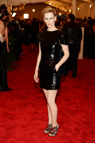 January Jones went with a little black sequined Chanel dress from the Spring 2009 collection, complete with these Nicholas Kirkwood tartan peep-toe booties and a Genevieve Jones ear cuff.
