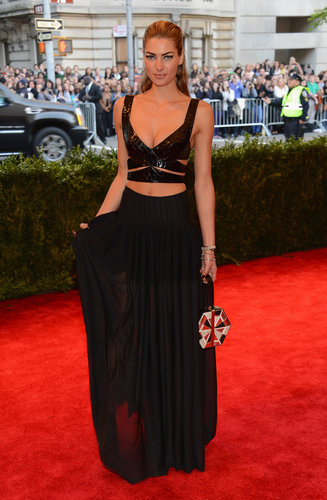 Jessica Hart wasn't afraid to show some skin in a black leather cutout crop top and a sheer black maxi skirt. Don't forget the major Chopard diamonds.