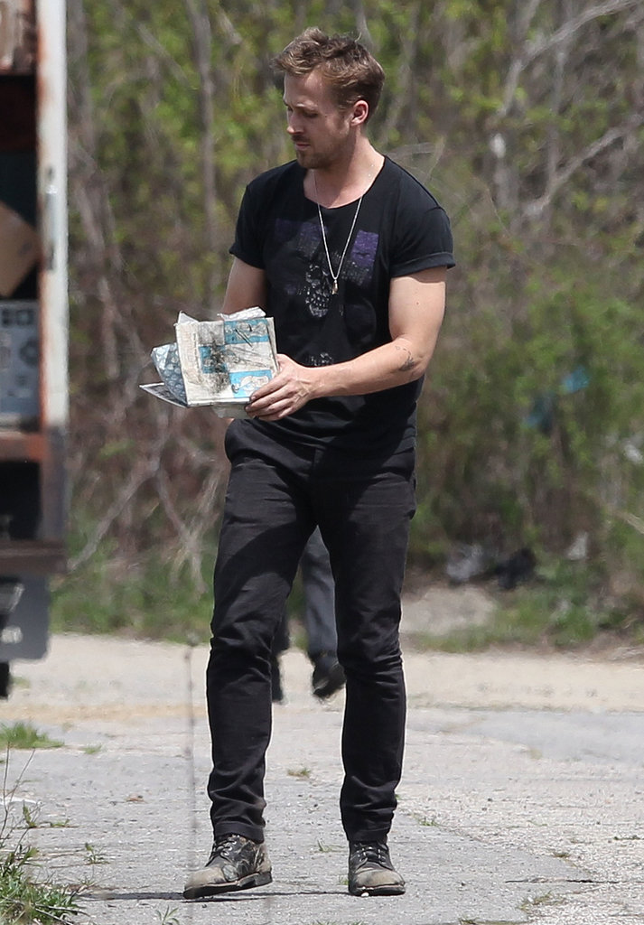 Ryan Gosling looked through papers.