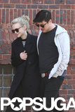 Carey Mulligan flashed a smile with Marcus Mumford.