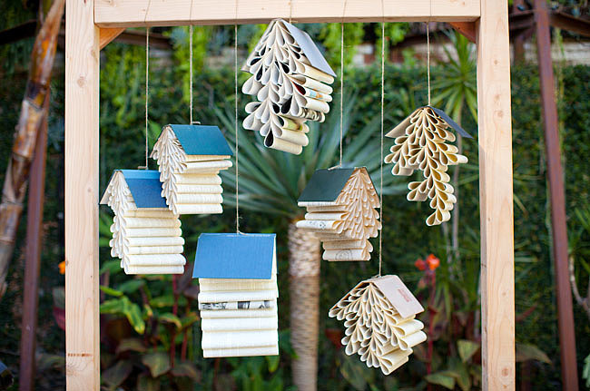 Book-lovers, take note. Made with hanging books, this creative backdrop is a sweet touch for the couple that reads together (and stays together).  Photo by Sarah Yates of Birds of a Feather via Green Wedding Shoes