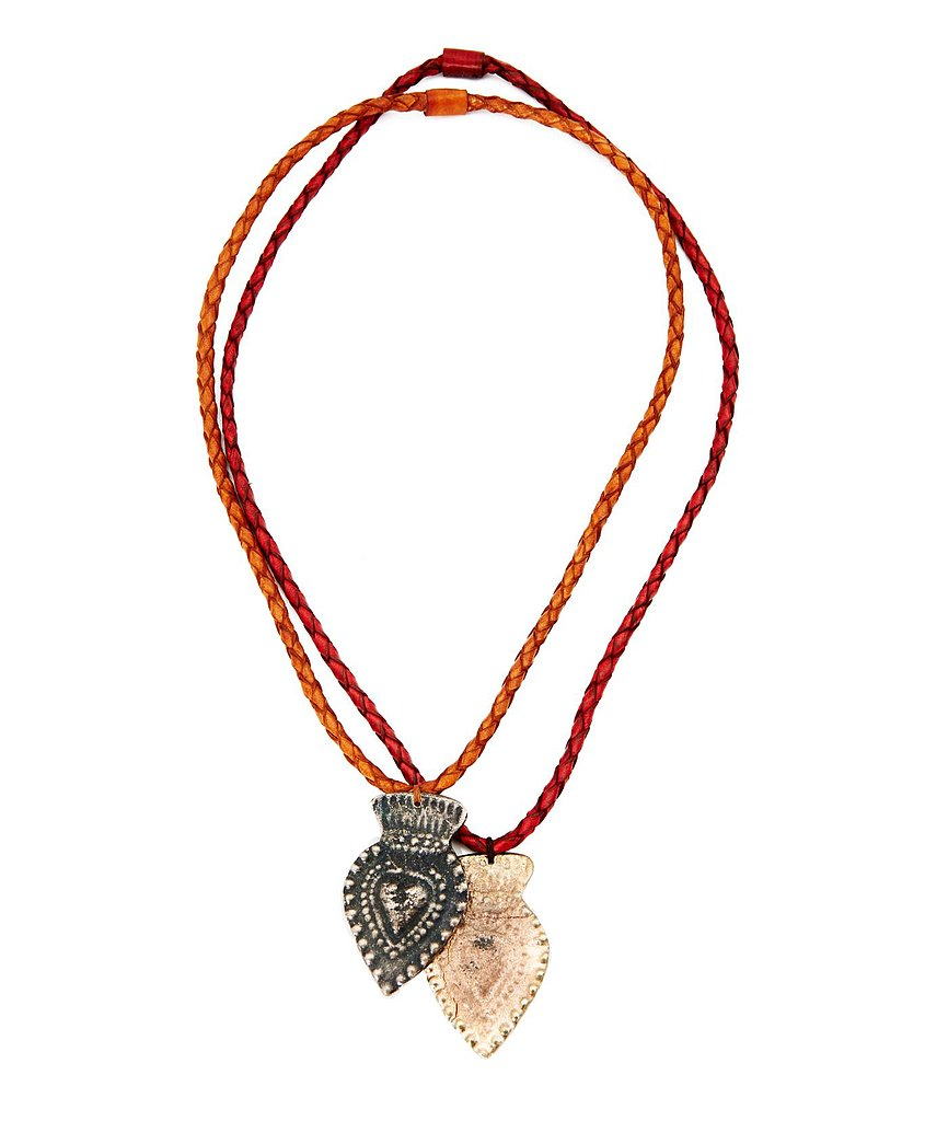 Pair this Mexican Bazaar large heart leather Milagros necklace ($56) with a draped white tee and printed shorts for a boho-traveler look.