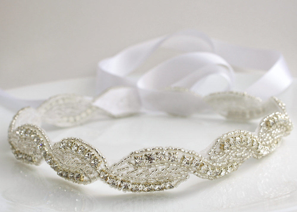 Tie on this appliqué crystal bridal ribbon headband ($68) to a variety of hairstyles.