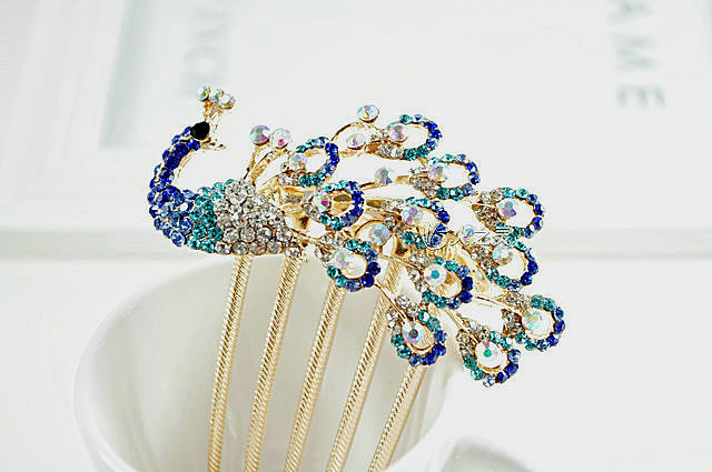 "A nontraditional bride should go for something playful like a peacock hair comb ($25), which could also serve as your ""something blue."""