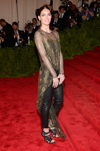 Hilary Rhoda climbed the famous red stairs in a Wes Gordon ensemble, which included a sheer gold lace top with a floor-grazing tail and black leather pants.