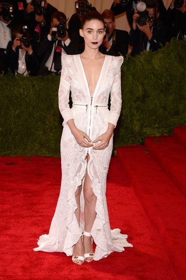 Rooney Mara's interpretation of punk looked a little something like this: a sheer white Givenchy Haute Couture by Riccardo Tisci custom-made gown with exposed zippers and ruffles. She finished the look with white Givenchy sandals.