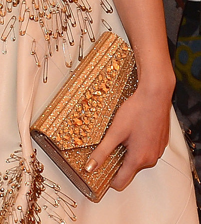 Hailee Steinfeld carried a Jimmy Choo clutch.