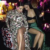 Kim Kardashian showed off her legs with a fellow partygoer. Source: Instagram user kristennoelgipson