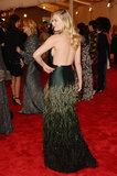 Kirsten Dunst channeled her sexier side in Louis Vuitton gown that bared her back.