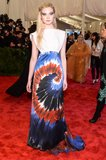 Rodarte Printed Tie Dye Silk Satin Gown with 3D Double-Faced Foam Bib ($5,980), worn by Elle Fanning Source: Joe Schildhorn/BFAnyc.com