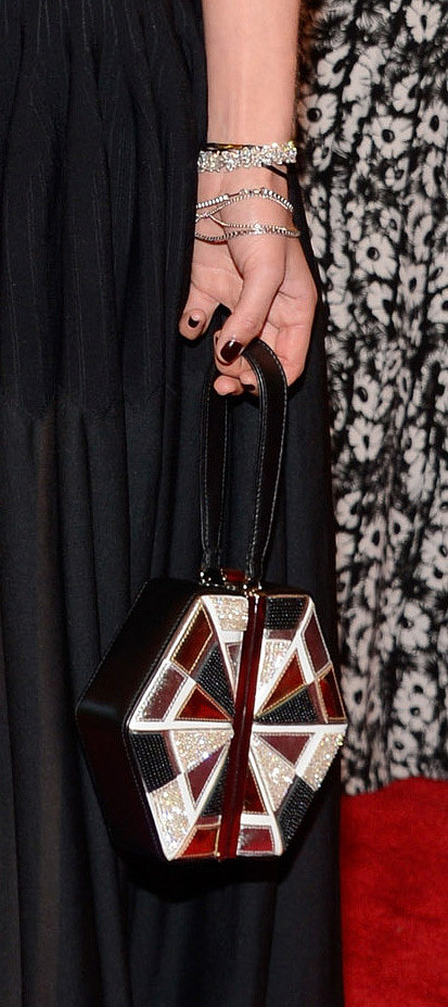 Jessica Hart carried a geometric clutch and wore Chopard diamond bracelets.