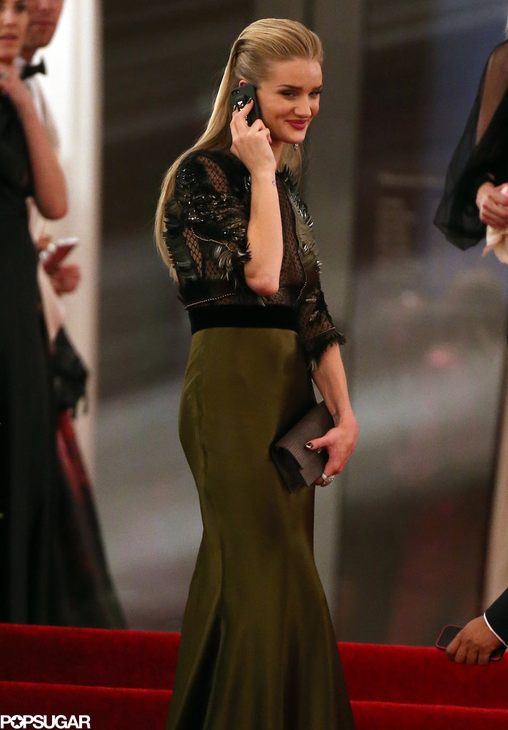 Rosie Huntington-Whiteley talked on her cell phone.