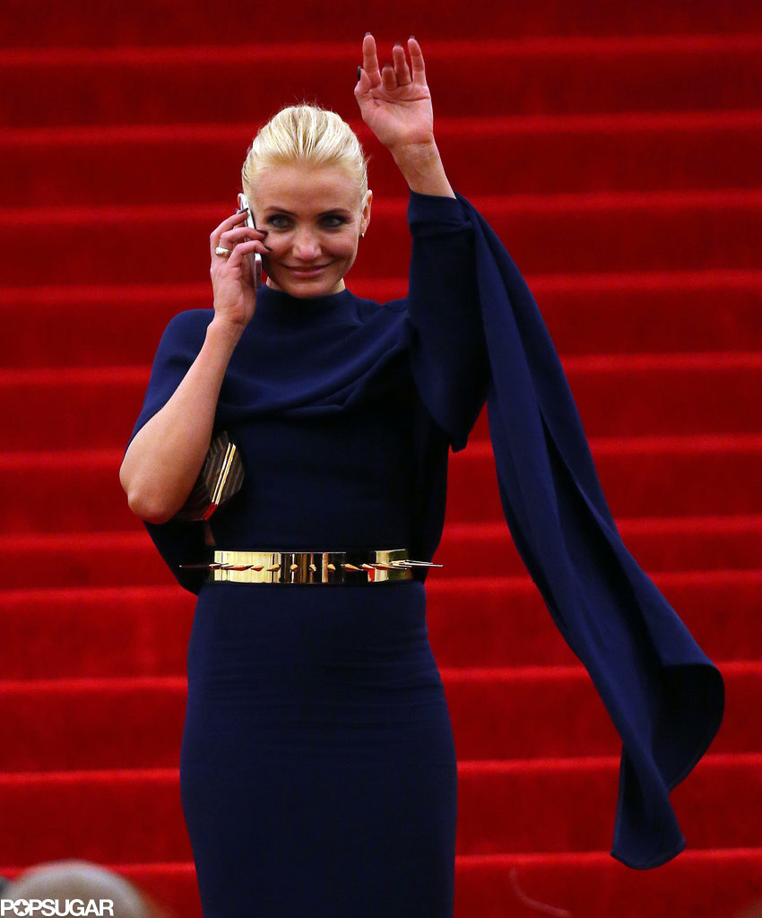 Cameron Diaz talked on her cell phone and waved at fans.