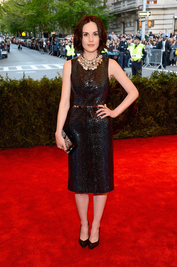 Michelle Dockery also wore Burberry, this one happens to be a python-print leather shift dress with Gianvito Rossi pumps.