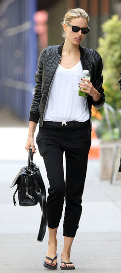 Karolina Kurkova's black leather bomber jacket injected instant luxe to her white tee and black sweatpants in NYC.