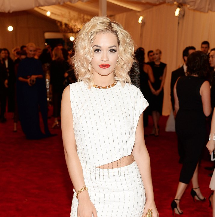 Rita Ora left most of the punk in her outfit, but her signature red lips and platinum blonde hair definitely pays homage to the Material Girl era.