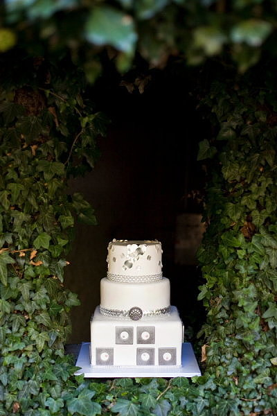 Between the metallic embellishments and geometric detail, we can't get enough of this unique cake.  Photo by Tana Photography via Style Me Pretty