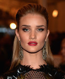 Rosie Huntington-Whiteley added glamour with a stunning pair of earrings.