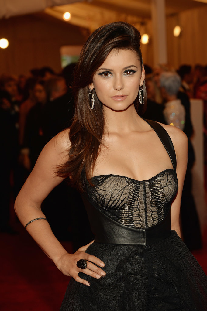 Nina Dobrev furthered the drama of her sheer bustier-style gown with major drop earrings and a cocktail ring.