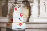Between the fun colors and funky patterns, this cake is ready to party.  Photo by Jasmine Star via Green Wedding Shoes