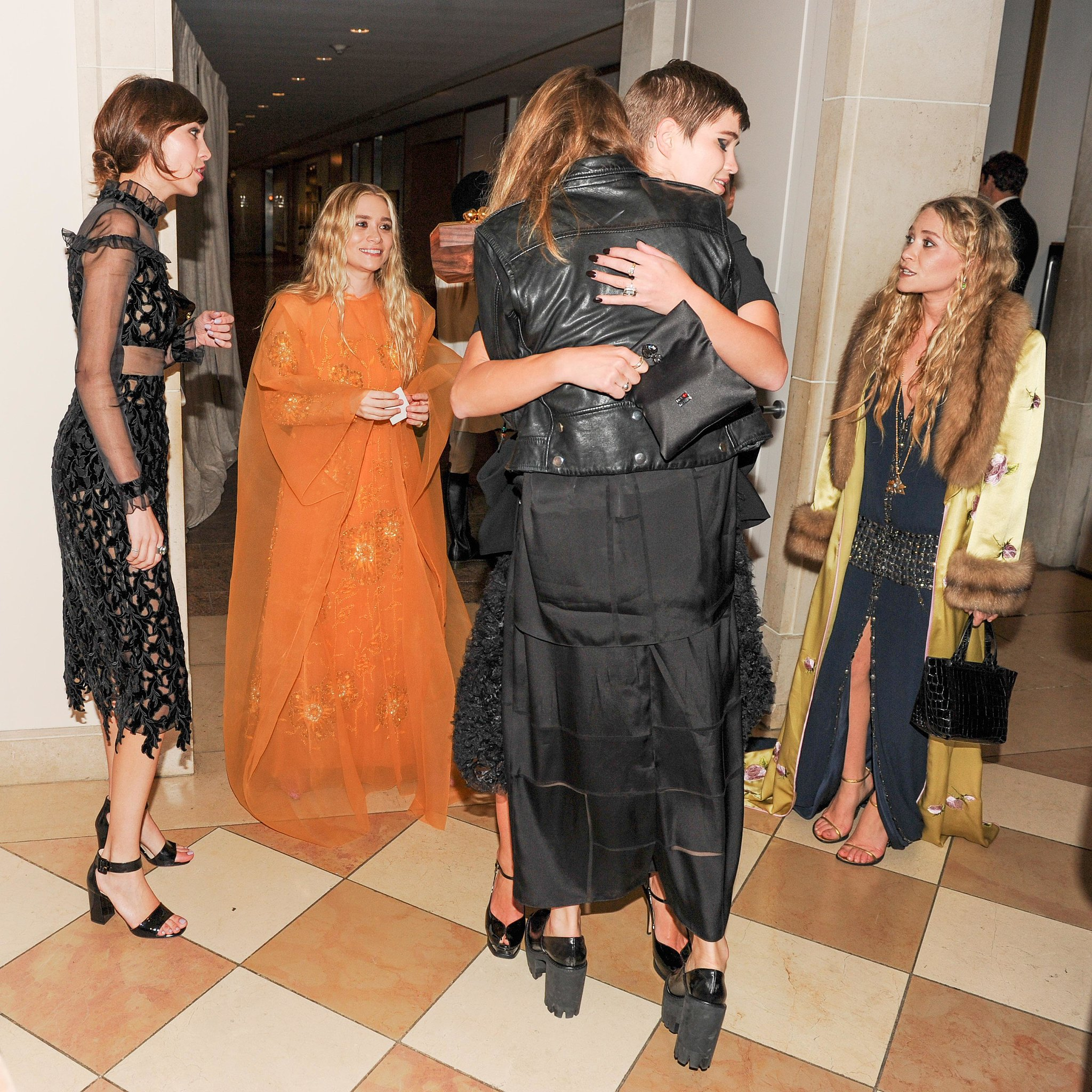 Mary-Kate and Ashley Olsen watched as their fashion friends hugged it out inside the Met Gala.  Source: Billy Farrell/BFANYC.com
