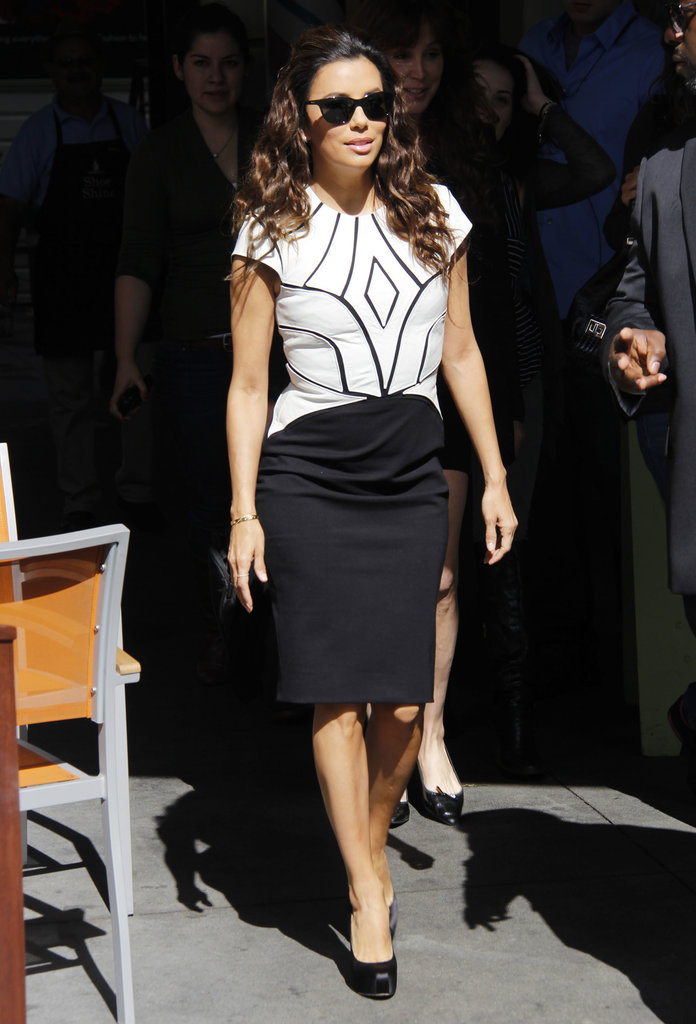 Eva Longoria kept things formfitting in a black and white Catherine Deane sheath. She added black sunglasses for cool and platform pumps for height.