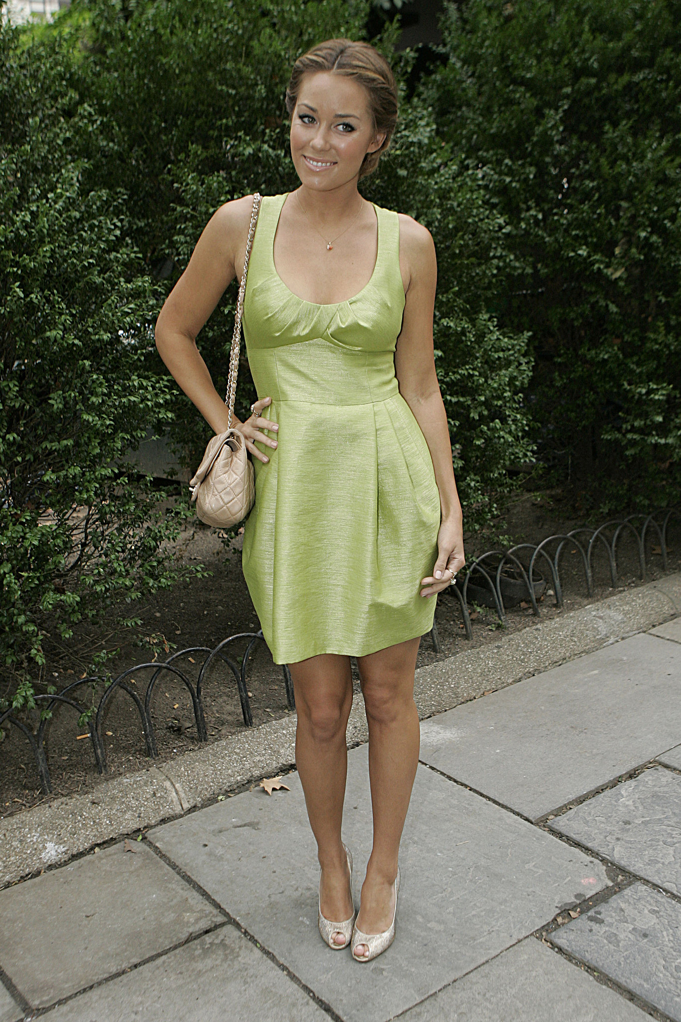LC attended New York Fashion Week in a mint green dress in 2009. Lesson from Lauren: pastels play up a sun-kissed glow.