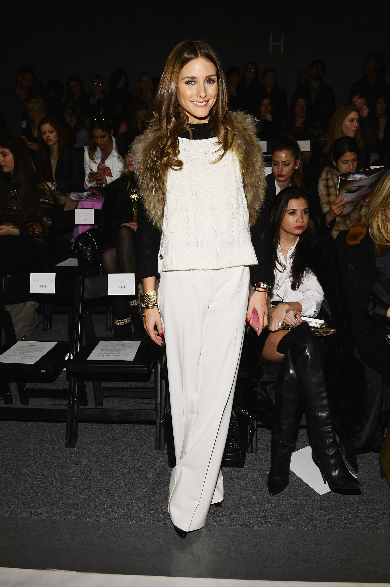 We love how Olivia's furry vest lent a touch of texture to her colorblocked top and slick white trousers at the Rachel Zoe show in NYC.