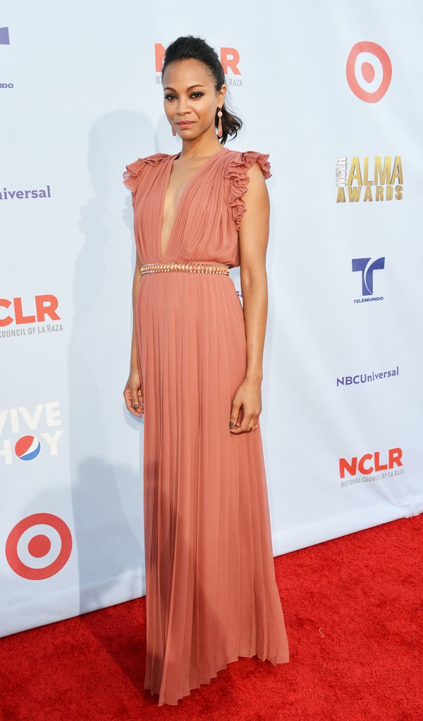 Between the soft hue, pleats, and ruffles, Zoe Saldana's peachy Gucci gown will make all your bridesmaids feel so pretty. This look can work everywhere from a black-tie wedding to a lush garden event.