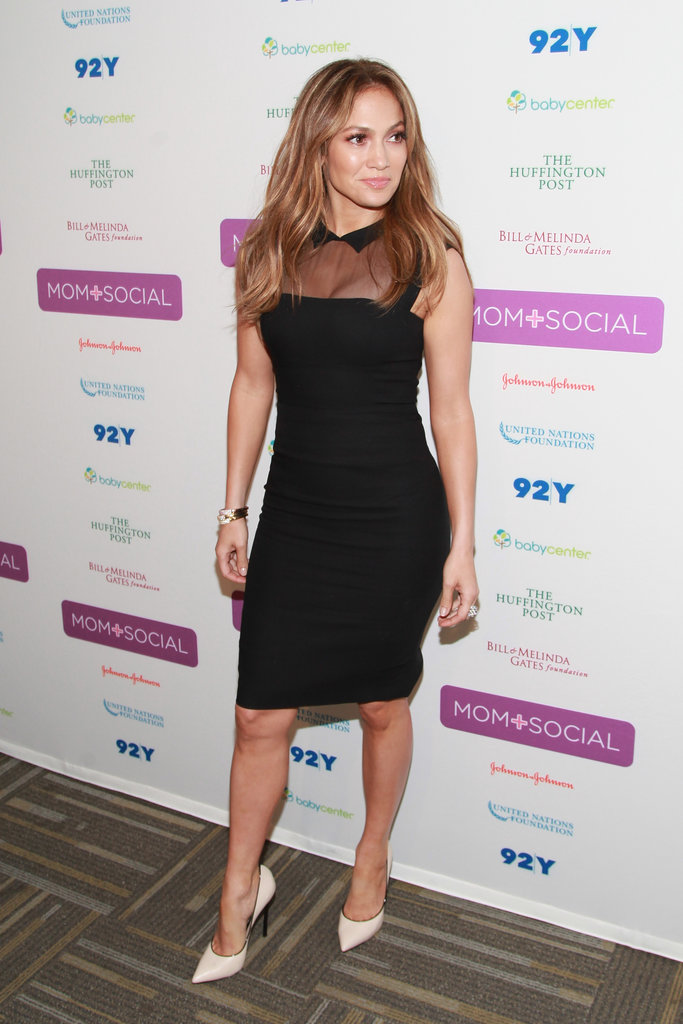 Jennifer Lopez amped up her sheer, collared L'Wren Scott little black dress with white Casadei pumps at an event in NYC.