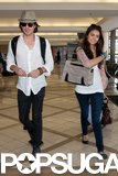 In July 2011, Nina Dobrev and Ian Somerhalder shared a smile while walking through an airport.