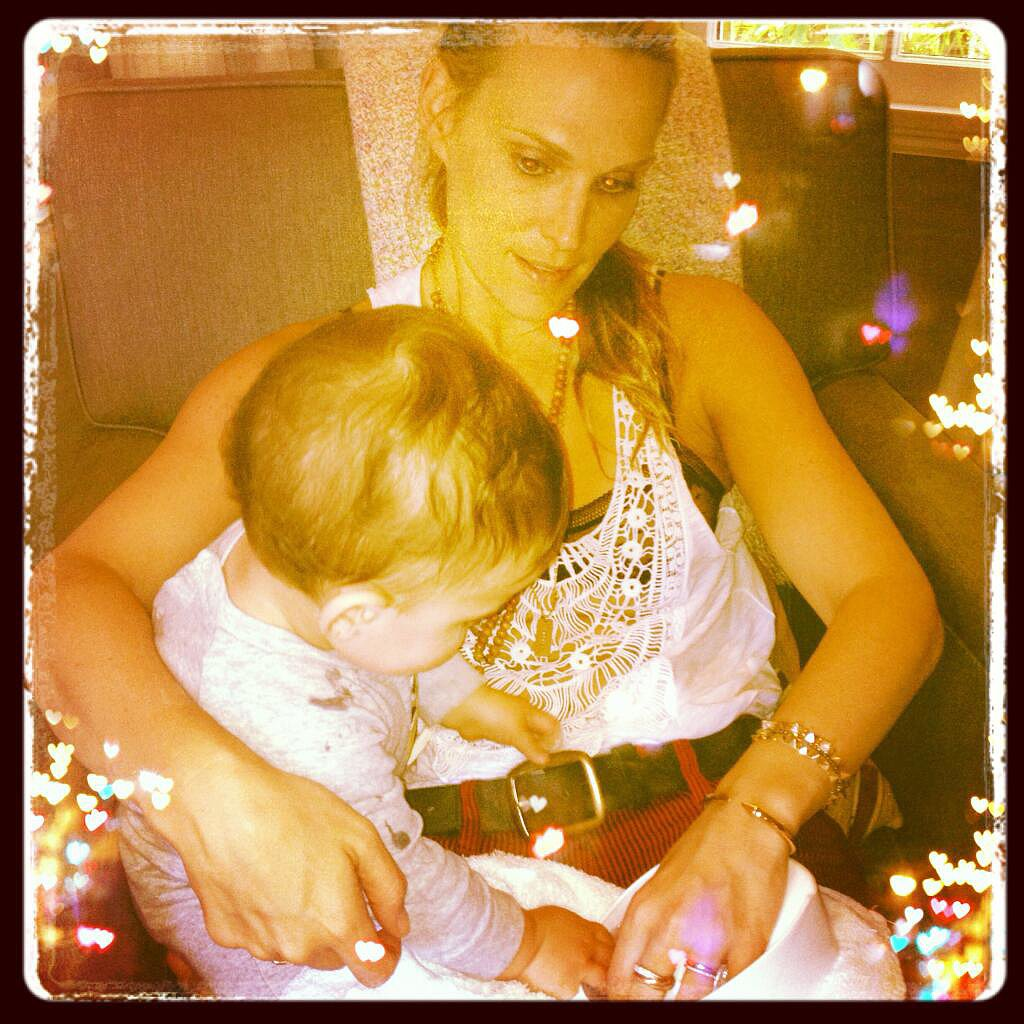Brooks Stuber found mom Molly Sims's belt fascinating! Source: Twitter user MollyBSims