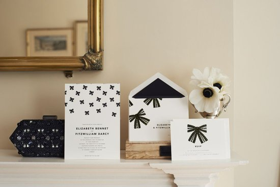 "These bow invitations (prices vary) are a cute play on ""tying the knot."" We love the sleek black-and-white combination, especially if you want to set the tone for a more modern celebration."