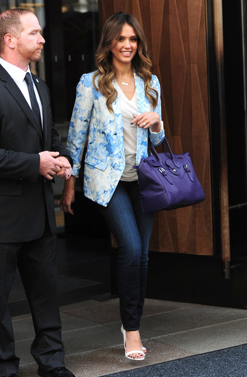 While in NYC, Jessica Alba punched up her skinny denim and basic white tee via this Tibi Daisies blazer ($595), white Aldo Rise x Preen white ankle-strap sandals, and a purple bag.
