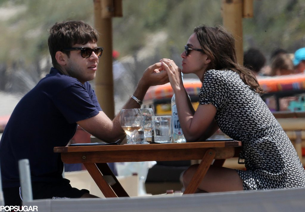 James Righton and Keira Knightley held hands across the table.