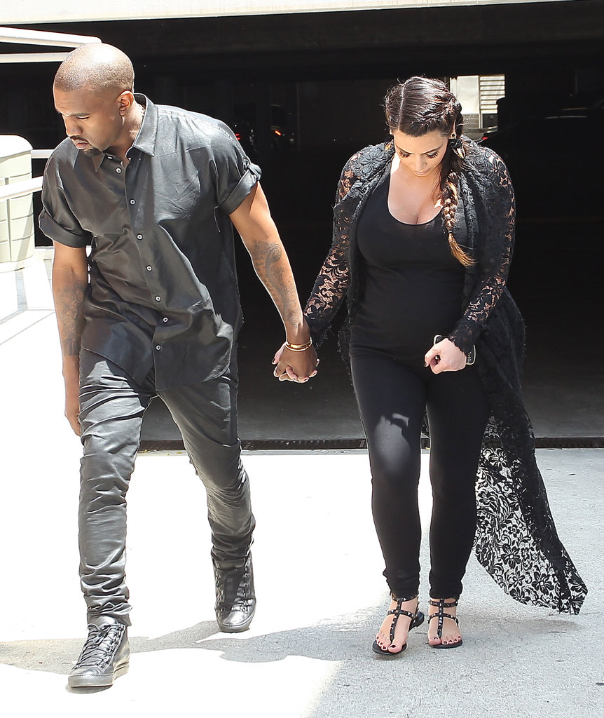 Kanye West and Kim Kardashian held hands in LA on Friday.