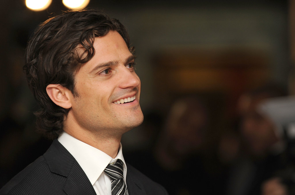 The prince flashed a sweet smile at a London exhibition in 2011.