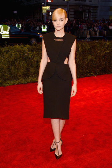 At the 2013 punk-themed Met Gala, Carey Mulligan stepped out in a black Balenciaga by Alexander Wang dress, complete with sexy side cutouts and a giant safety pin at the neckline. Her sleek T-strap pumps and slicked bob provided the finishing touches.