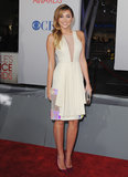 Miley toyed with the idea of going sexy and futuristic for the People's Choice Awards in January 2012 — she chose a pale-colored David Koma dress with sheer cutouts and gemstone paneling, and she accessorized with a Marchesa clutch and metallic Jimmy Choo heels.