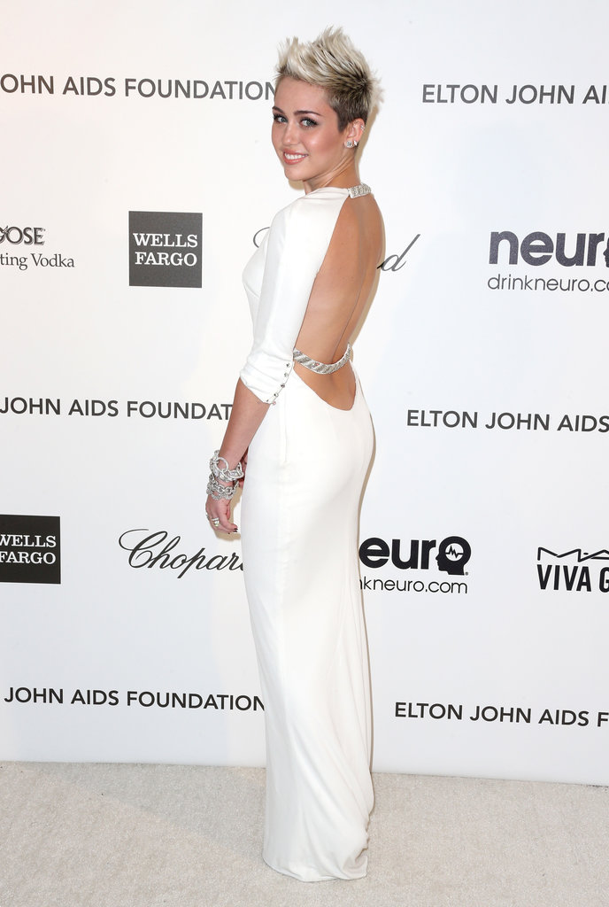Miley was the picture of sexy sophistication at Elton John's annual Oscars viewing party in February. Her white, long-sleeved Emilio Pucci gown was tempered with an open back — it perfectly fused Miley's sultry side with a hint of Old Hollywood glamour.