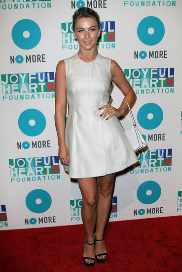 Julianne Hough wore head-to-toe Calvin Klein Collection at the 2013 Joyful Heart Foundation Gala in NYC. She paired a white fit-and-flare dress with black ankle-strap sandals and a white structured bag, resulting in a retro-chic vibe.