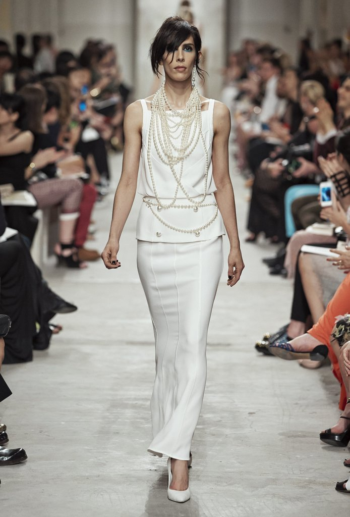 A simple shape and draped pearls combined for a timeless look. Source: Chanel