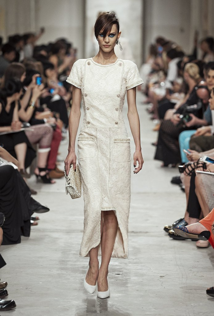 A ladylike dress dabbled in the world of menswear with double-breasted details. Source: Chanel