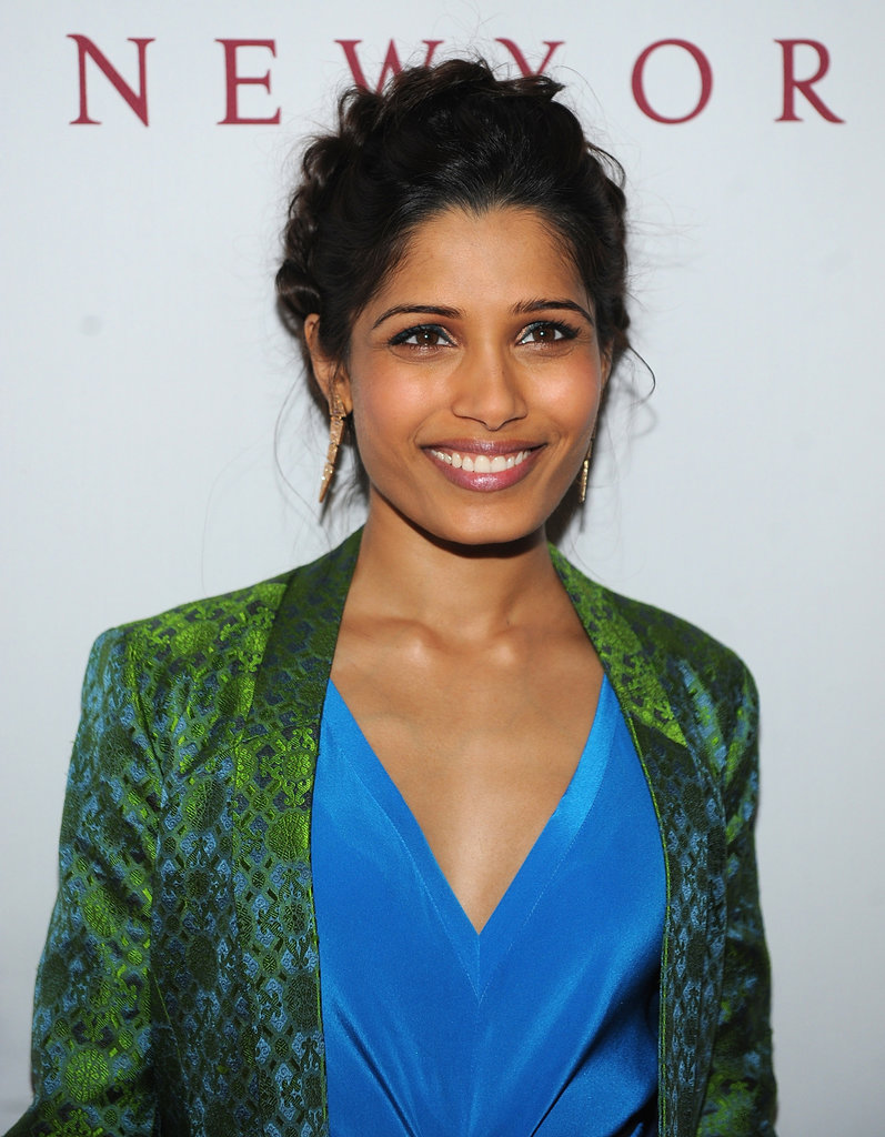 Freida Pinto was spotted at a Barneys event with a braided updo, well-lined eyes, and mauve lips.