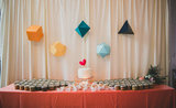 If you plan on having a homemade cake, then allow its simplicity to stand out against a brightly colored geometric backdrop.  Photo by  Studio Castillero via Green Wedding Shoes