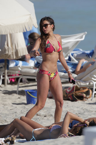 Nina Dobrev's floral bikini stood out on the beach in Miami in April 2013.