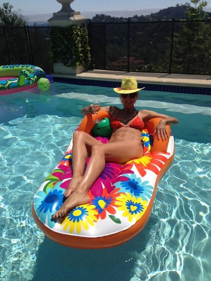 "Heidi Klum celebrated in the pool with a nice glass of wine in her hand. She tweeted, ""Happy Mother's Day! Best Mother's Day ever...."" Source: Twitter user heidiklum"